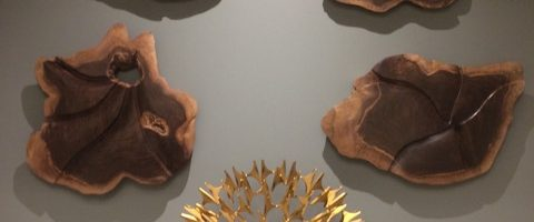 Four Walnut Wall Sculptures Installation