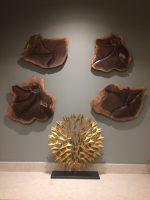 4 walnut wall sculptures Installation